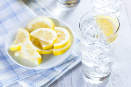 Refreshing Ice Cold Water with Lemon ready to drink